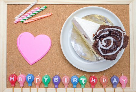 birth day: Cake,colorful Birth day candles and post it on cork board background