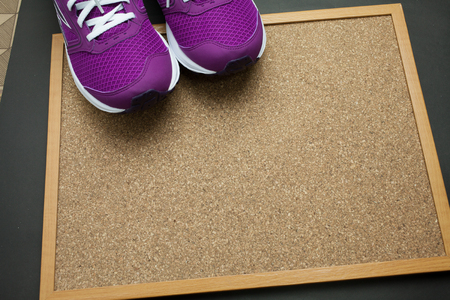 pin board: Purple Sneakers on Pin board with wooden background