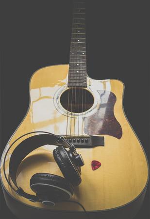 guitar pick: Guitar ,headphone and guitar pick Stock Photo