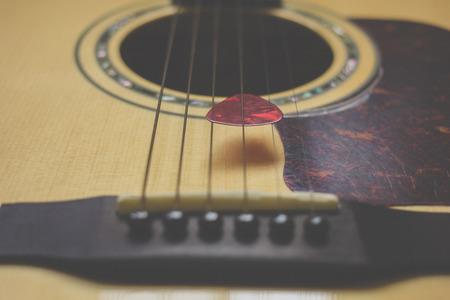 guitar pick: Part of guitar and guitar pick body close up