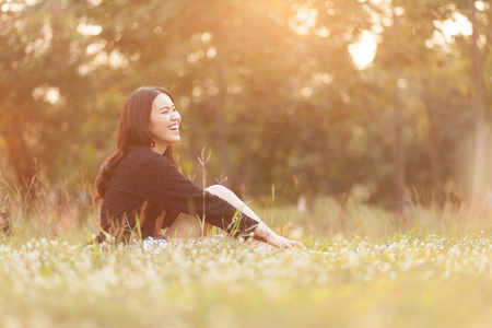 Pretty Thai girl Smiling at the park Stock Photo