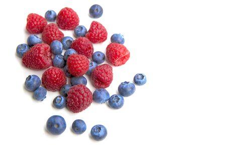 Fresh blueberries, raspberry isolated on white background.