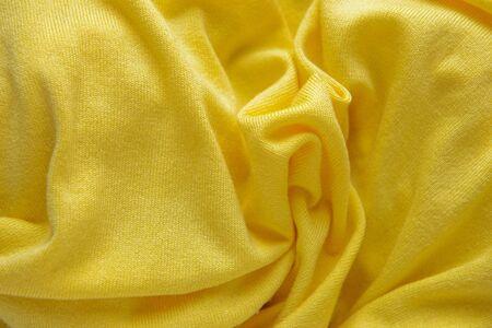 Yellow beautiful delicate texture. Light yellow knit fabric.