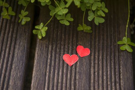 Valentines day card with hearts on a wooden background, love message