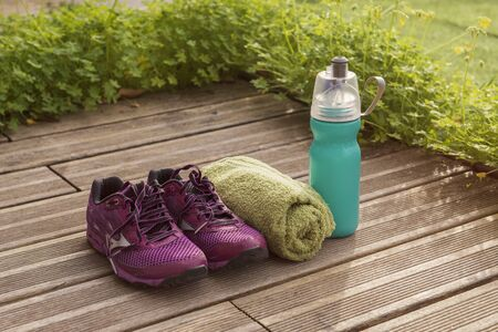 Wellness it is life. Sport it is life. sneakers, water bottle and towel