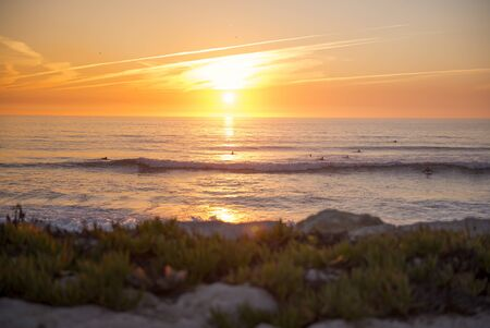 Sunset every day with surfers. Surfers in Atlantic Ocean. Beautiful sunset. Stock Photo