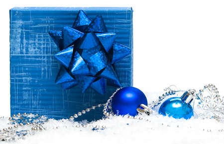 festive balls with gift box on snow