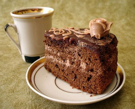 slice of chocolate cake on plate and cup  photo