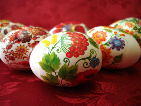 beautiful easter eggs on red background  photo