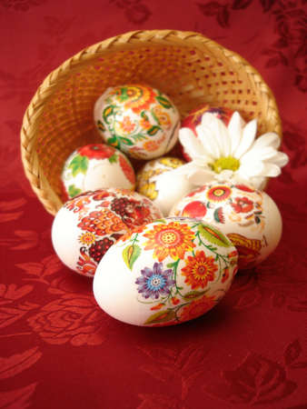 easter eggs and basket on red background  photo