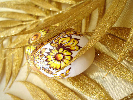 eastertime: easter egg with golden leaves