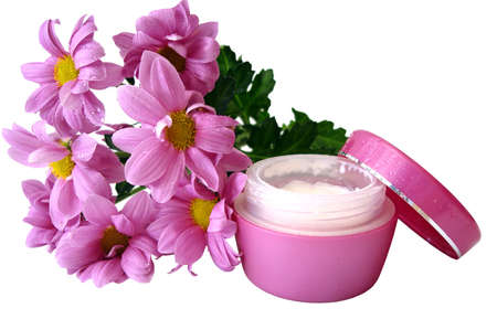 moisten: violet container of cosmetic moisturizing cream with flowers  Stock Photo