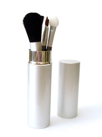 set of make-up brushes on white  photo