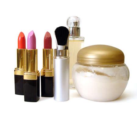 set for make-up (cream, brushes, perfume and lipsticks)  Stock Photo