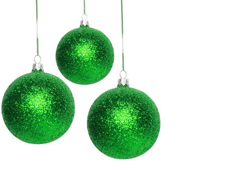 green Christmas balls over white background  photo
