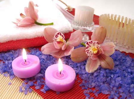 Spa essentials (salt, towels, candles, brushes and pink orchids)  photo