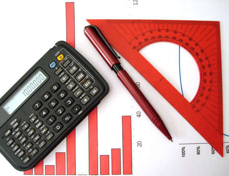 calculator, pen, ruler and red diagram of financial report Stock Photo - 1067258