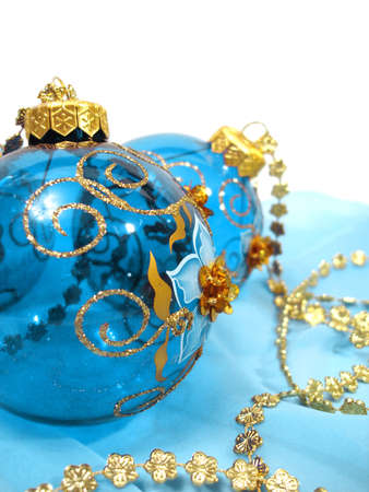blue Christmas balls with gold on background