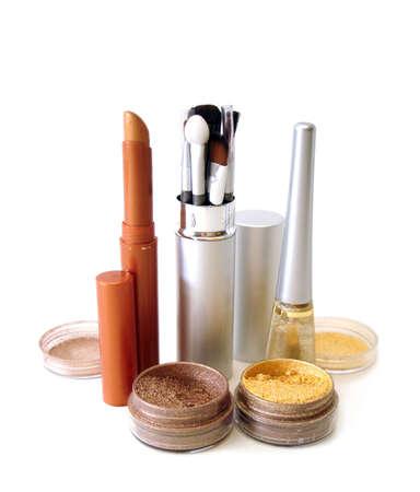 rouge: golden set for make-up (brushes, eyeshadows, rouge, nail polish and lipstick)  Stock Photo
