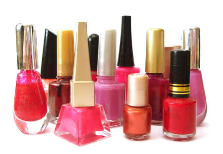 cosmetic lacquer: red and pink nail polish on white background