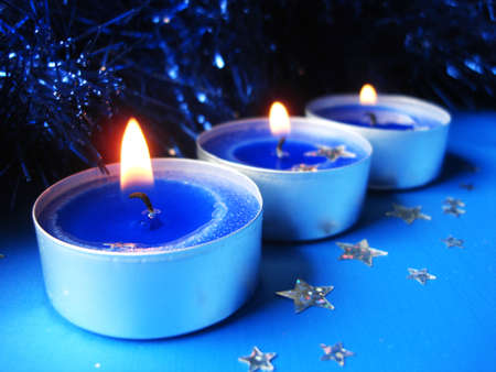 blue candles with decoration stars Stock Photo - 1557983