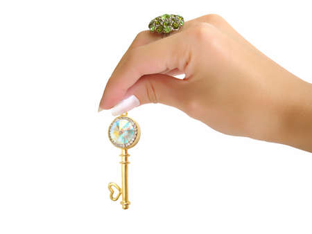 brilliants: Golden key with brilliants on hand isolated