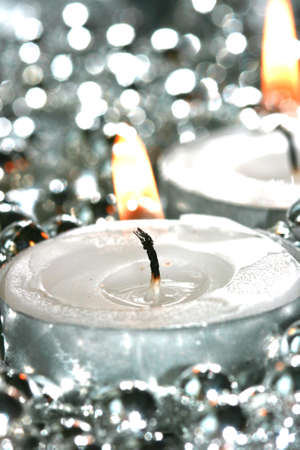 white candles with silver decoration balls  photo