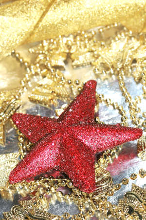 red Christmas decoration star on golden background Stock Photo - 2079746