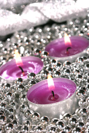 pink candles with silver decoration balls  photo
