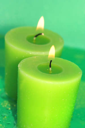 green burning candles on background Stock Photo - 2079730