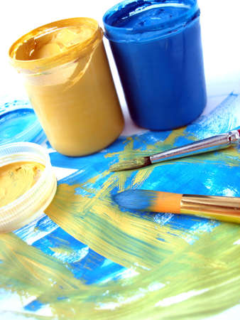 blue and yellow paint jar with gouache  photo