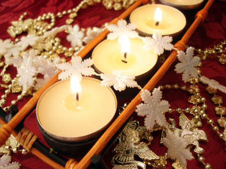 row of candles with snowflakes  photo