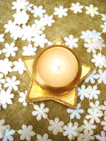 golden candle with white snowflakes Stock Photo - 2182967