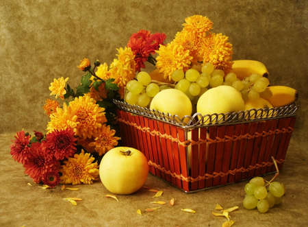 stilllife: Harvest still-life: fruits on basket and flowers