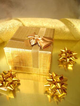golden gift box and celebration ribbon Stock Photo - 2182964