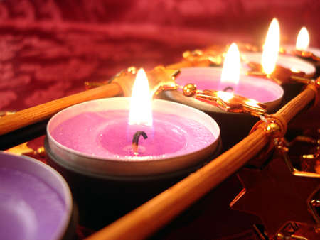christmas scent: row of pink candles with stars, close-up Stock Photo