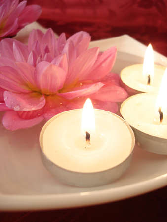 Spa essentials (candles and pink flowers on water)  photo