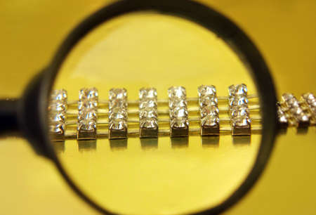 coulomb: find the diamond necklace with magnifying glass  Stock Photo