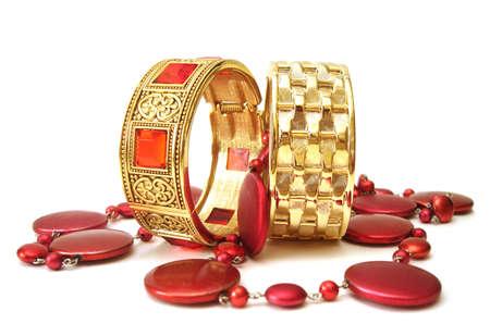 golden bracelets with beads isolated on white background  photo