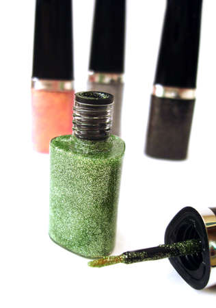 fangle: green nail polish or lipstick on white background