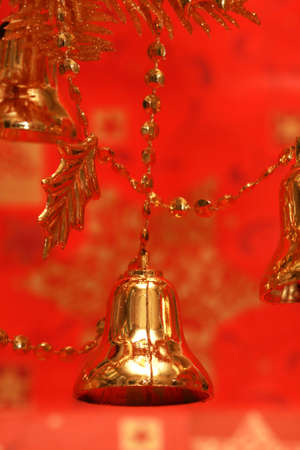 new-year handbells and Christmas tree on red background  Stock Photo - 2207288