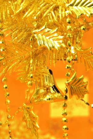new-year handbells and Christmas tree on orange background  Stock Photo - 2207312