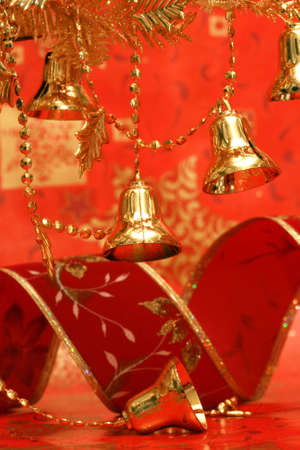 new-year handbells and Christmas tree on red background  photo