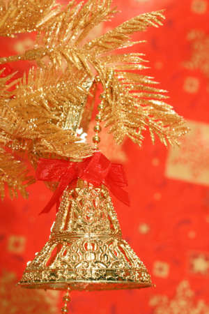 new-year handbells and Christmas tree on red background Stock Photo - 2207347