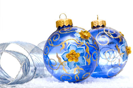 blue Christmas balls on snow background  photo
