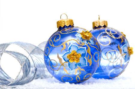 blue Christmas balls on snow background  photo