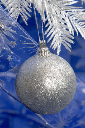silver Christmas ball on blue background Stock Photo - 2207382