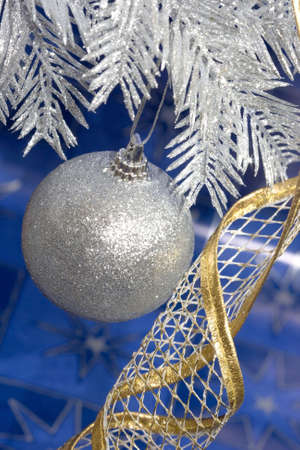 silver Christmas ball on blue background Stock Photo - 2207385