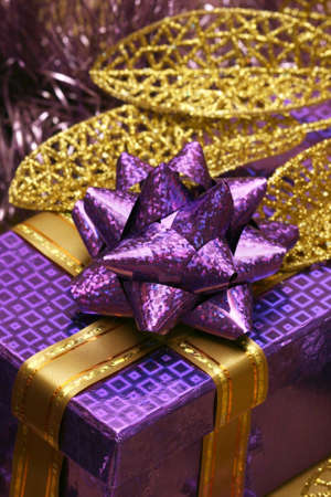 violet gift box and golden celebration leaves Stock Photo - 2207344