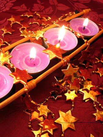 row of pink candles with stars Stock Photo - 2222324